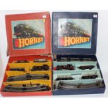 Two Hornby 'O' sets: 1954-8 No 40 tank goods comprising 0-4-0 c/w BR82011 loco (G) wih 3 wagons,
