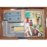 Tray containing various Hornby and continental style buildings including goods shed, station