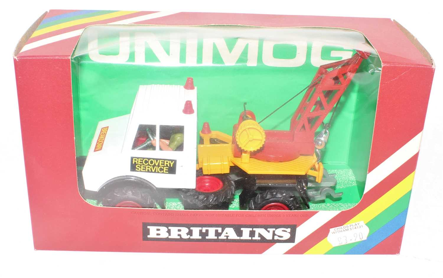 A Britains No.9581 UNIMOG breakdown truck comprising of a white cab and black chassis with yellow