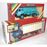 A Britains farm series 1/32 scale boxed group to include No. 9604 milk transporter and a No. 9580