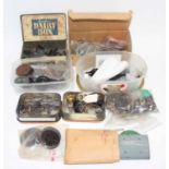 Box containing variety of spare parts of which approx. 35 are 0 gauge loco driving wheels, with