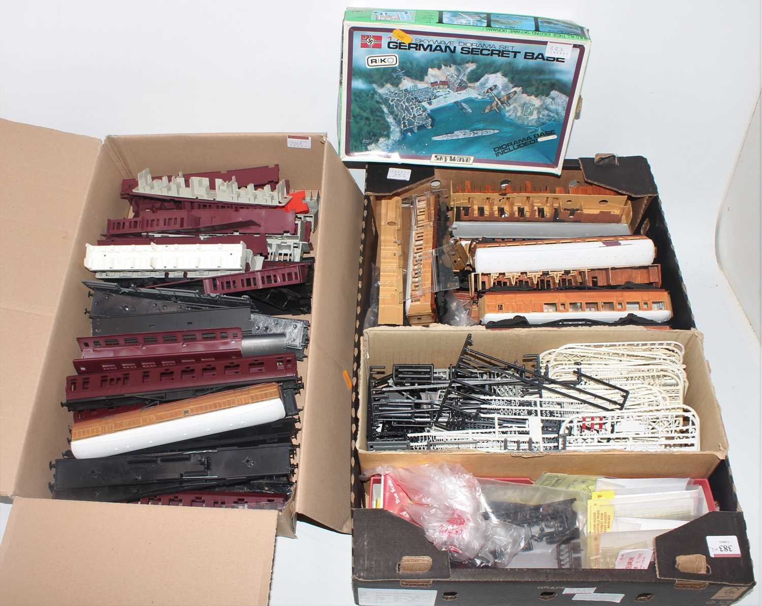 Two trays of part made kit items including coaches with and without interiors and many other items