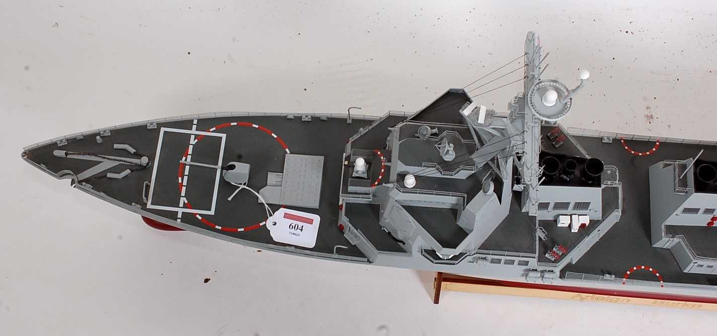 A kit built model of an Arleigh Burke No. 82 destroyer, finished in red, grey and black, with - Image 3 of 3