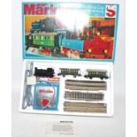 Marklin HO train set ref. 2920 comprising 0-6-0 tank loco with two open end 4-wheel coaches, track