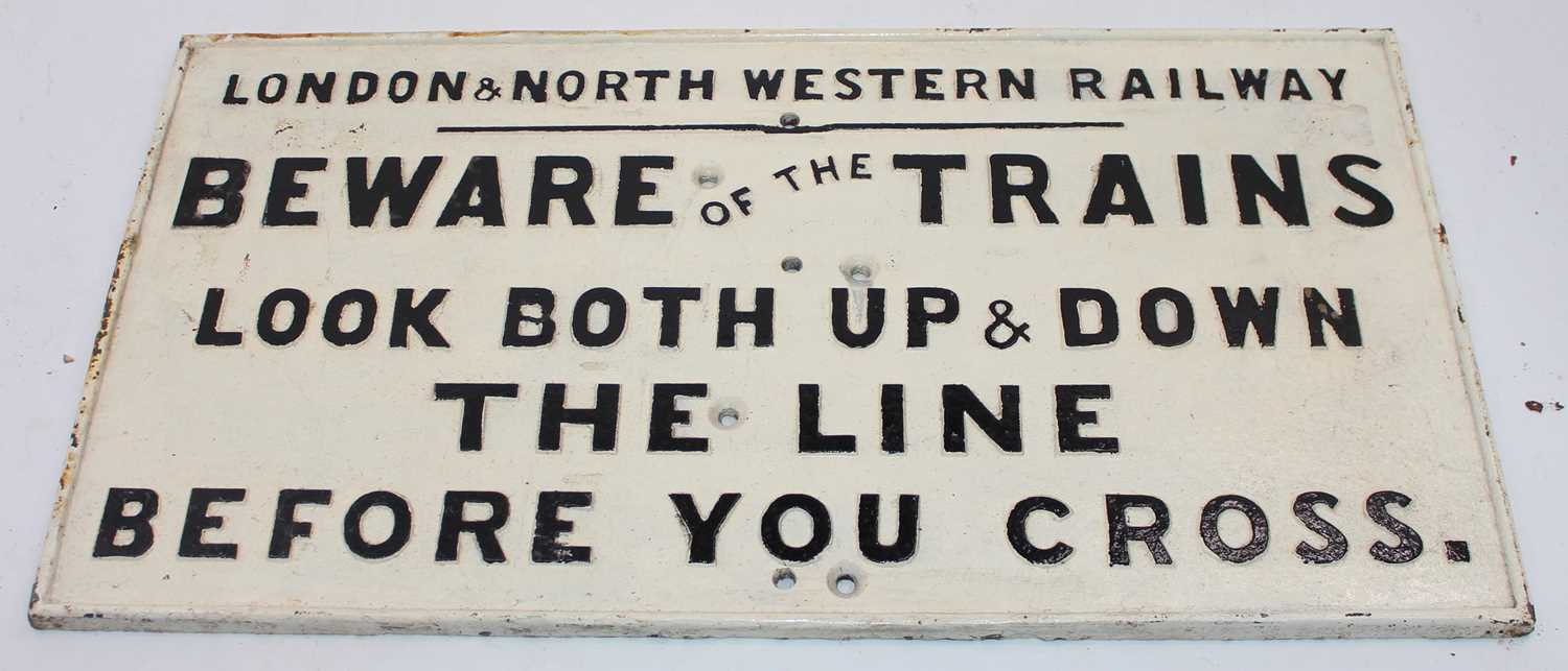 A London and North Western Railway 'Beware of the Trains' cast-iron notice, finished in black on