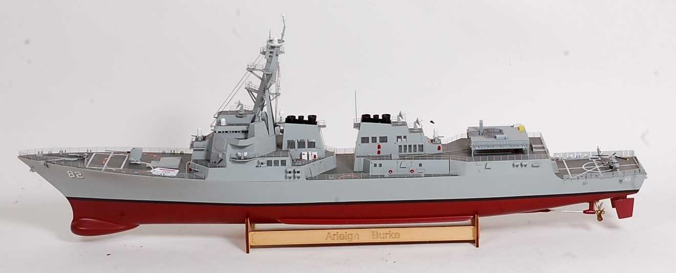A kit built model of an Arleigh Burke No. 82 destroyer, finished in red, grey and black, with