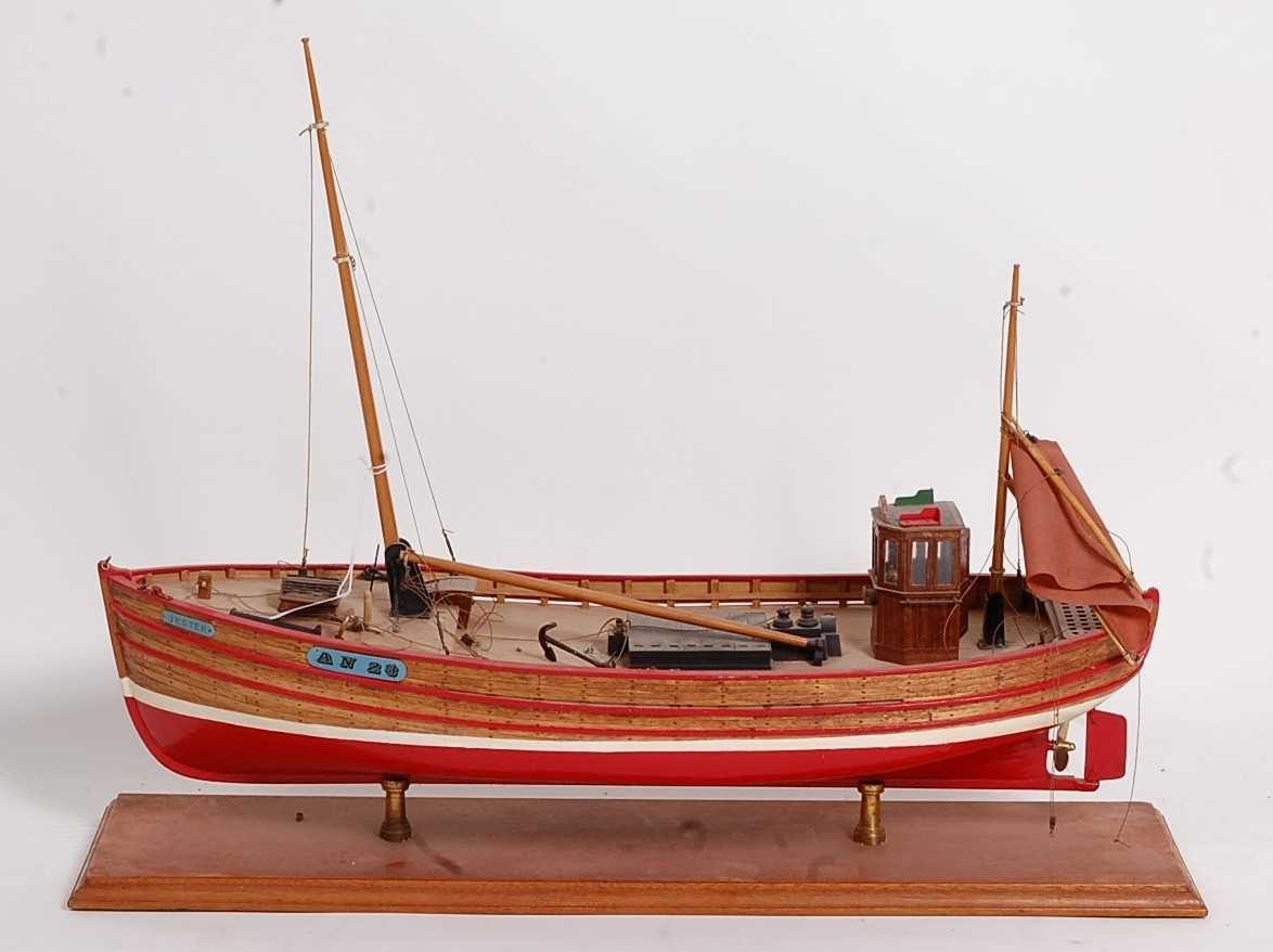 A wooden kit built solid planked hull model of a Jester AN23 fishing boat, static model raised on