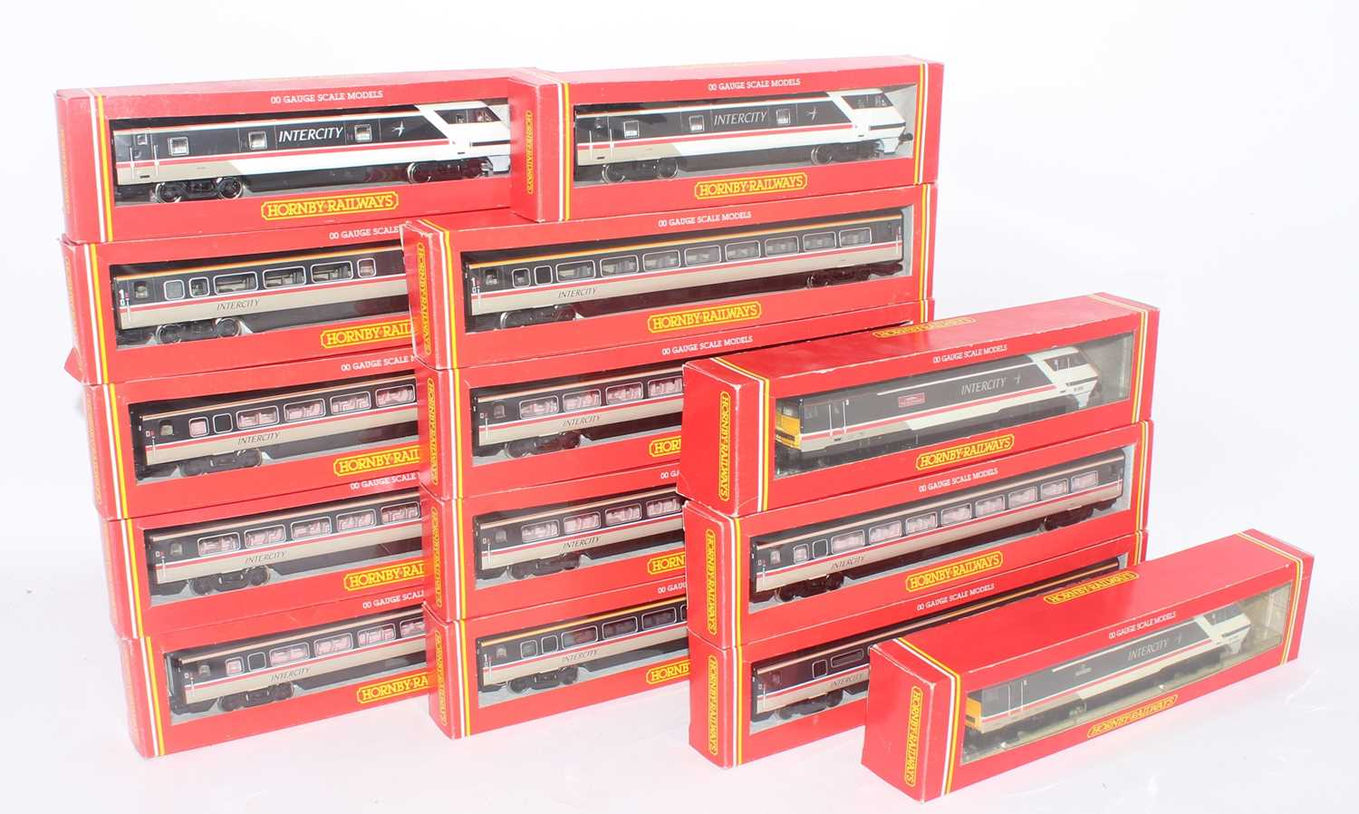 Fourteen various boxed Hornby 00 gauge Intercity locomotives, coaches, and dummy cars, all housed in
