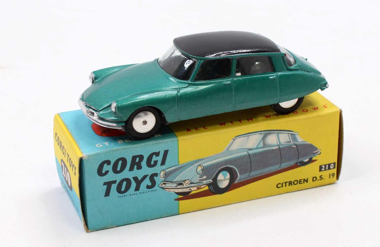 A Corgi Toys No. 210 Citroen DS19 comprising metallic dark green body, with black roof and spun