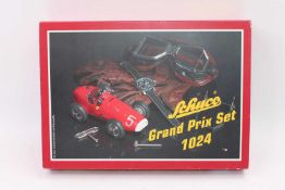 A Schuco Set No. 1024 Ferrari Grand Prix gift set of tinplate construction, housed in the original