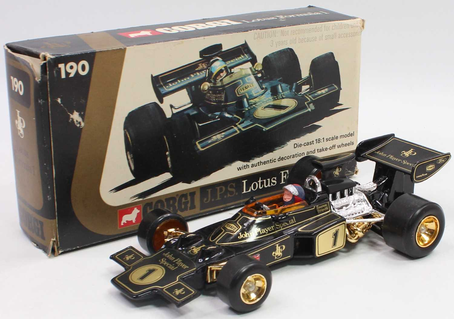 A Corgi Toys No. 190 JPS Lotus F1 race car, 1/18 scale comprising of black and gold body housed in