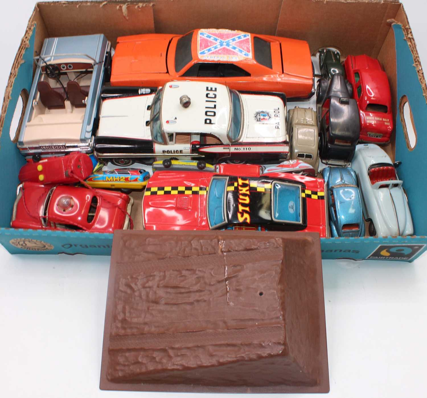 Collection of various loose play worn, tinplate cars and plastic novelty toys to include Minic