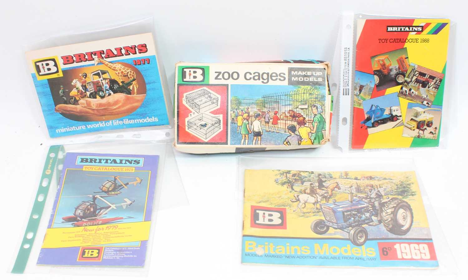 A collection of various Britains related items to include catalogue No. 4370 Britains plastic zoo
