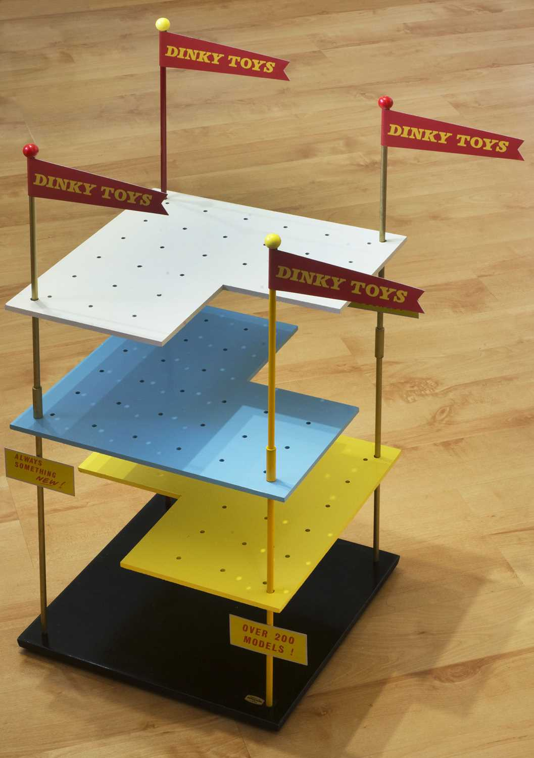 An original Dinky Toys wooden and metal shop/dealer display stand comprising of a wooden base with - Image 2 of 2