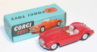 Corgi Toys 302, M.G.A sports car in red, mint condition with flat spun hubs with Corgi leaflet in