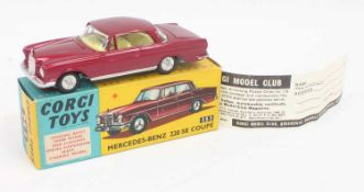Corgi Toys No 253 Mercedes Benz 220 SE Coupe in wine red and fitted with a yellow interior (model