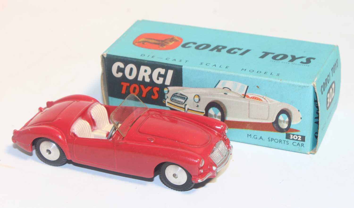 Corgi Toys 302, M.G.A sports car in red, mint condition with flat spun hubs with Corgi leaflet in - Image 2 of 3