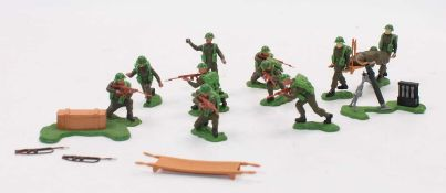 A collection of various Britains Swoppets British plastic military figures to include a kneeling