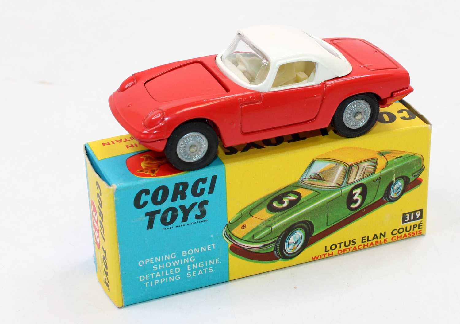 Corgi Toys No. 319 Lotus Elan Coupe comprising red body with white roof and cream interior, with