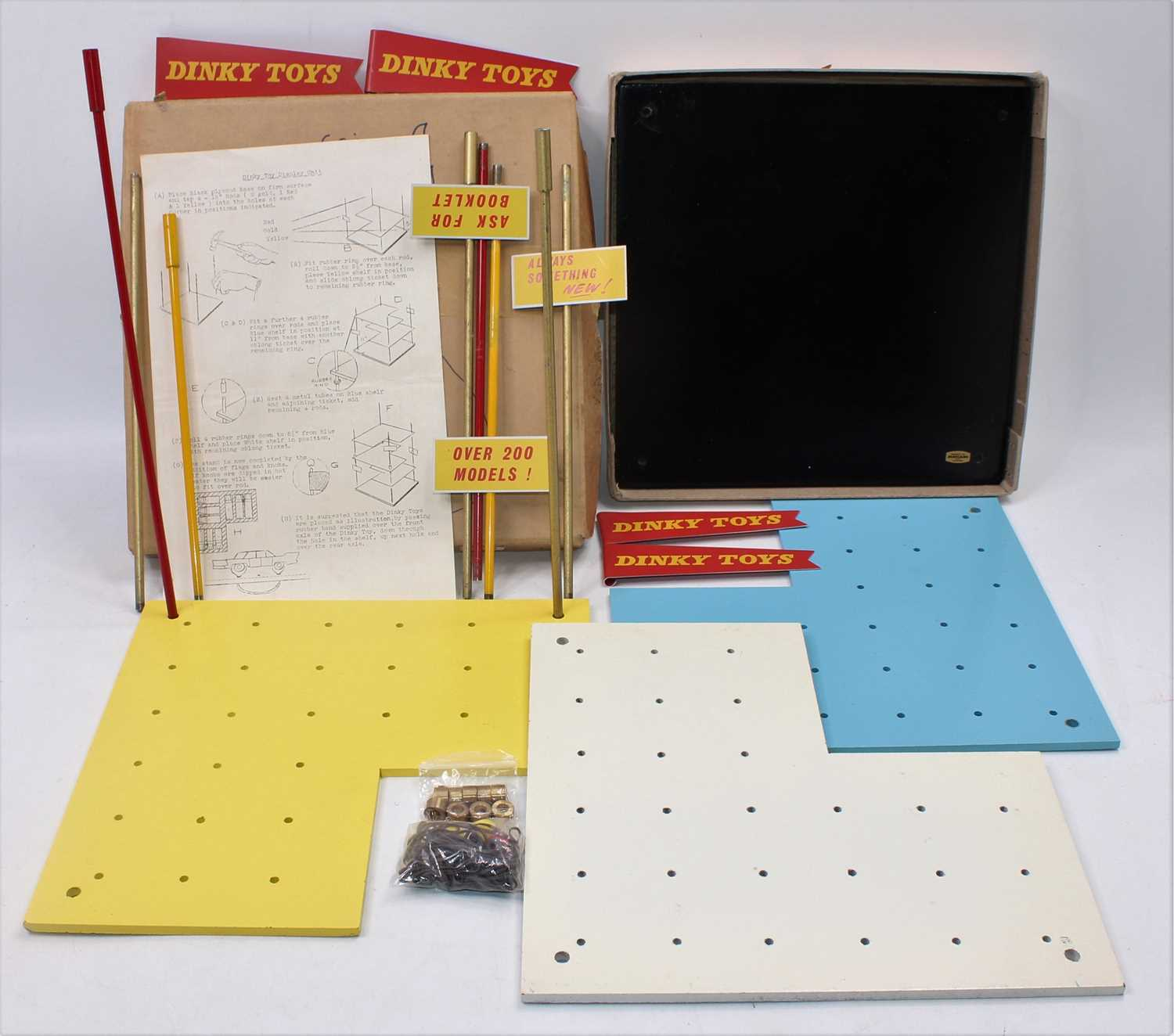 An original Dinky Toys wooden and metal shop/dealer display stand comprising of a wooden base with
