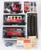 LGB 100 Years set comprising 0-4-0 steam outline loco 'No. 1' red/black with two 4-wheel red