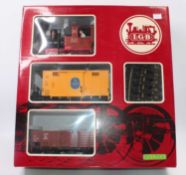 LGB goods set Ref. 20401 comprising 0-4--0 steam outline loco 'Lydia' black/red/brown with two 4-