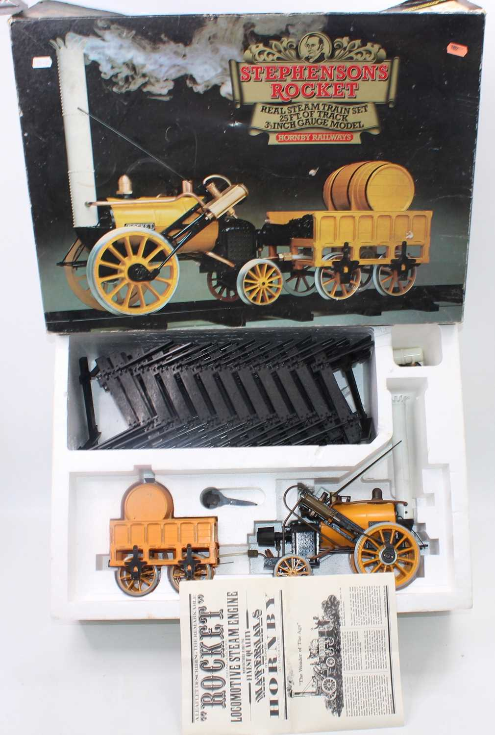 """A Hornby 3.5"""" gauge Stephensons Rocket gift set, comprising of locomotive and tender, with a"""