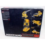 A Meccano boxed motorised construction kit group, two examples being a No.4M and No.5 gift set, both