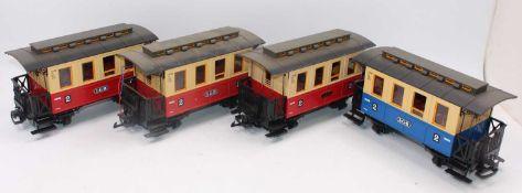 Large tray containing 4x LGB 4-wheel verandah coaches, 3x red/cream 2nd class and 1x blue/cream