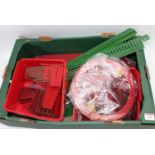 One fruit tray containing a quantity of mixed Meccano components, to include blue and gold criss-