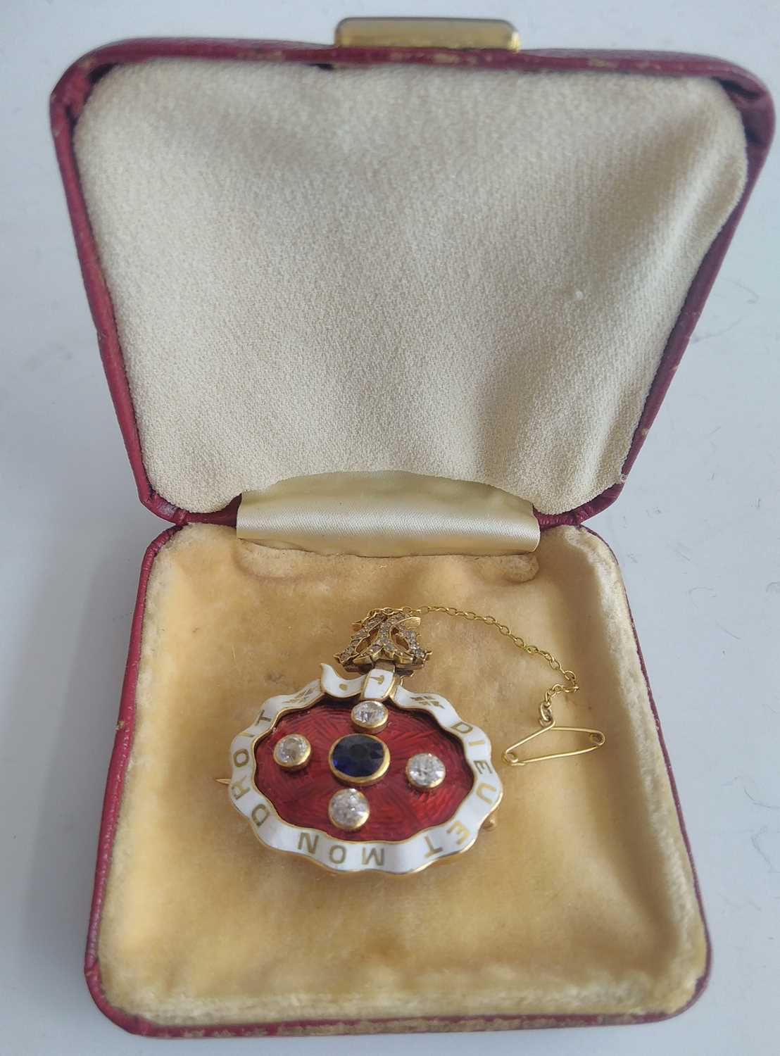 A yellow metal, sapphire and diamond enamel brooch, comprising an oval panel in red guilloche enamel - Image 6 of 9