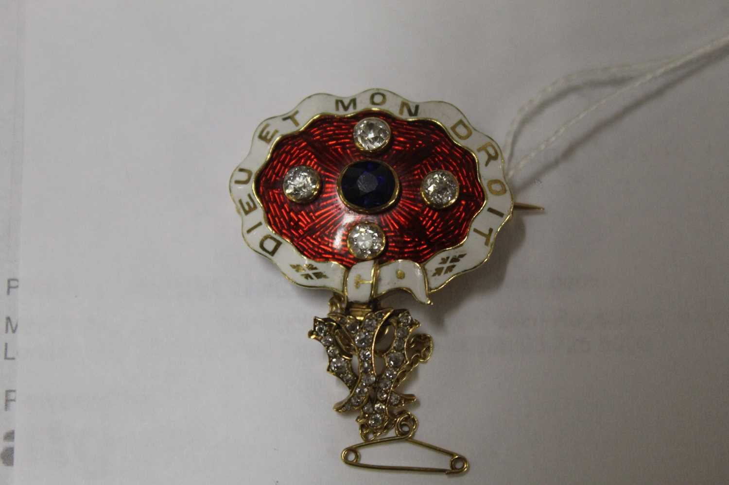 A yellow metal, sapphire and diamond enamel brooch, comprising an oval panel in red guilloche enamel - Image 7 of 9