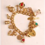 A 9ct yellow gold curblink bracelet, with padlock clasp and safety chain, 17 charms attached to