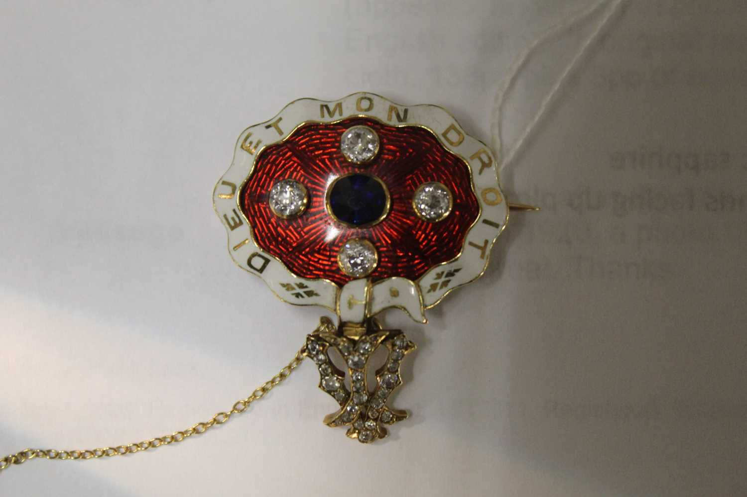 A yellow metal, sapphire and diamond enamel brooch, comprising an oval panel in red guilloche enamel - Image 2 of 9