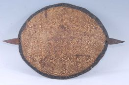A soft shell turtle shield, with a two pronged iron short spear bound with hide, Shilluk Kingdom,