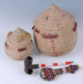 An African pipe, having two bowls to a single stem with applied red and white bead decoration, 24cm,