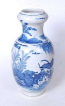 A Chinese export blue and white vase, having an onion top to a baluster body, underglaze blue