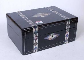 A Victorian ebonised mother of pearl and paua shell inlaid lady's work box, the hinged lid opening
