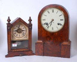 A Victorian walnut cased dome top mantel clock having a circular enamel dial with Roman numerals
