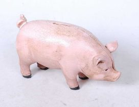 A reproduction cast metal money-box in the form of a pig
