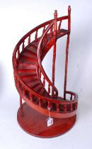 A modern stained ply model of a spiral staircase, h.60cm