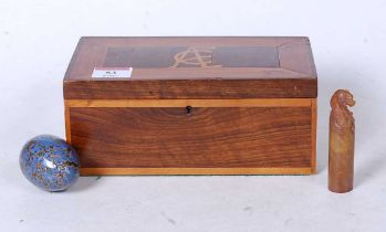 An early 20th century rosewood, boxwood, and yew wood glove box of hinged rectangular form,