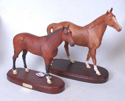 A Royal Doulton figure of the racehorse Nijinsky, on an oval base with brass plaque, having