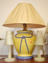 A pair of onyx table lamps, each having a trumpet shaped shade, h.27cm; together with a large yellow
