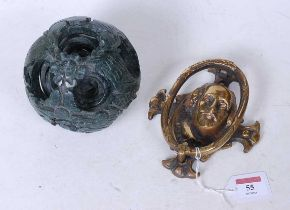 A carved and polished hard stone puzzle ball, together with a brass door knocker in the form of