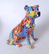A modern model of a seated dog, with all-over decoupage type decoration, h.36cm