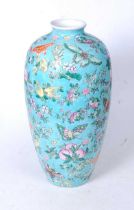 A Chinese export Meiping vase, on a turquoise ground enamel decorated with butterflies and