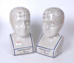 A pair of reproduction glazed ceramic phrenology busts, h.29cm