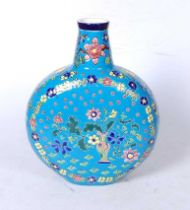 A modern Longwy style moonflask, of typical circular form, on a blue ground, the centre enamel