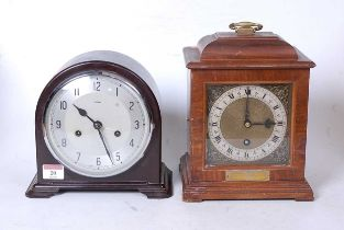 A mid-20th century walnut cased mantel clock, in the 18th century style, having a silvered dial with
